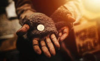poor man with a coin